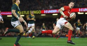 Hadleigh Parkes of Wales stretches clear of South Africa's  Andries Coetzee to score his side's third try. Photograph: Getty Images