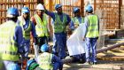 Construction workers on Khalifa International Stadium ahead of the 2022 World Cup in Qatar. Photograph: Warren Little/Getty Images