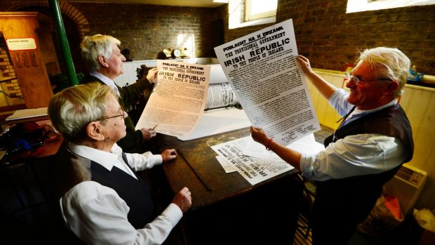 Printers Alf Mc Cormack, Billy Ryan and Freddie Snowe check the special limited edition print run of 100 copies of the Proclamation, to comemorate the 100th anniversary of the Rising at the National Print Museum. Photograph: Cyril Byrne
