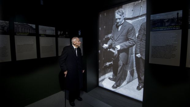 The late Liam Cosgrave stands in front of a photograph of his father WT Cosgrave at the GPO Witness History Visitor Centre during its official opening. Photograph: Brenda Fitzsimons