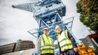 "Dublin Port Company chief executive Eamonn O' Reilly  with former crane operator Liam O'Brien. Its new ""cherry picker""  is a major part of Dublin Port's €6 million plan to better integrate itself with the city. Photograph:  Conor McCabe Photography"