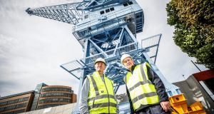 Dublin Port Company chief executive Eamonn O' Reilly with former crane operator Liam O'Brien. Its new Crane 292 is a major part of Dublin Port's €6 million plan to better integrate itself with the city. Photograph: Conor McCabe Photography