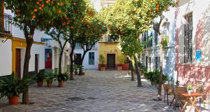 A corner of the famous Barrio Santa Cruz in Seville, with its typical orange trees