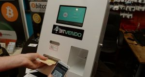 A customer uses a Bitcoin ATM in Dublin in 2014. Photograph: David Sleator