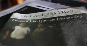 "Cambodian media: the final issue of the Cambodia Daily newspaper, with the headline ""Descent Into Outright Dictatorship"". Photograph: Satoshi Takahashi/LightRocket via Getty"