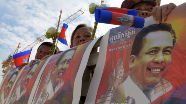 Cambodian media: a funeral procession for Kem Ley, a political commentator shot dead in July 2016. Photograph: Tang Chhin Sothy/AFP/Getty