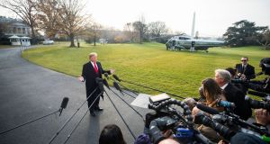 US president Donald Trump speaks to reporters at the White House on Monday as he departs for a trip to Utah. Photograph: Jim Lo Scalzo/EPA