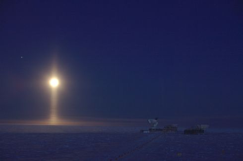 Lunar spotlight, South Pole, Antarctica by Daniel Michalik which was named as the winner in the Astronomy category.   Ice crystals suspended in the atmosphere create a rare optical phenomenon: a light pillar underneath the Moon.