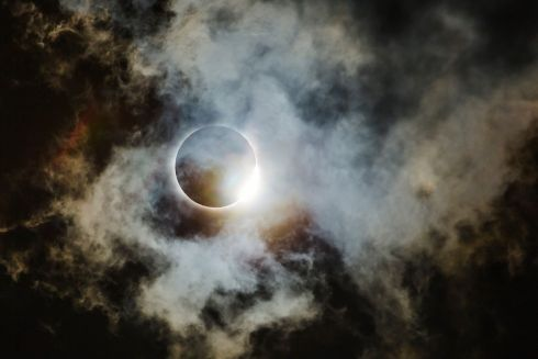 Diamond ring through thin clouds by Wei-Feng Xue which was named as runner up in the Astronomy category.  The American Eclipse of 2017 seen from the part of the path of totality that went through northern Georgia. This is the diamond ring lighting up some very thin cloud structures, looking almost like space clouds (i.e. a nebula).