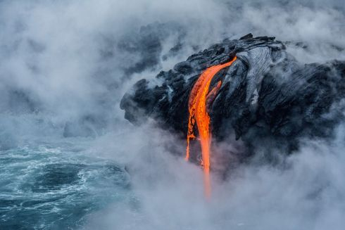 Pele's fire by Sabrina Koehler which was given an Honorable mention in the Earth Science and Climatology category.  The image shows the 61G lava flow at the Pu'u O'o eruption site of the active Kilauea volcano in Hawaii's Volcano National Park.