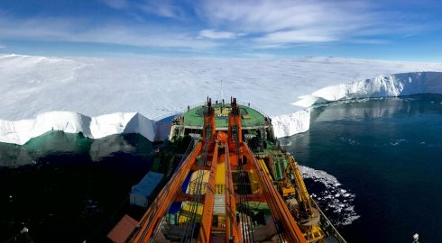 Giuseppe Suaria which was named as runner up in the Earth Science and Climatology category. The Russian research vessel Akademik Tryoshnikov leans the bow against the Mertz Glacier's snout in Eastern Antarctica. The photo was taken moments before deploying ROPOS, a Remotely Operated Underwater Vehicle (ROV) under the glacier tongue to investigate the melting of the ice-sheet after a piece of ice protruding 100 kilometres (62 miles) out into the Southern Ocean broke away from the main body of the tongue in 2010.