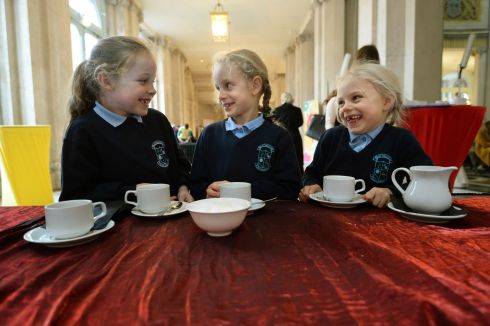 BACKSTAGE GOSSIP: Shannon Doherty (8), Rachel McPhillips (7) and Hannah McPhillips (6) from Killeevan National School in Co Monaghan, as primary schools gathered in Dublin City Hall  where the winners of the 'Someone Like Me?' national art competition were announced. Photograph: Dara Mac Donaill/The Irish Times