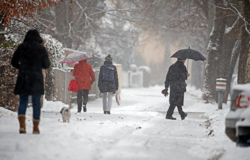 WHITE CHRISTMAS? Pedestrians walk on a snow-covered pavement in Munich, Germany, with the temperature expected to fall below zero degrees in the coming days. Photograph: Ronald Wittek/EPA