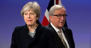 British prime minister Theresa May and European Commission president Jean-Claude Juncker prior to addressing a media conference at EU headquarters in Brussels on Monday.  Photograph: Virginia Mayo/AP
