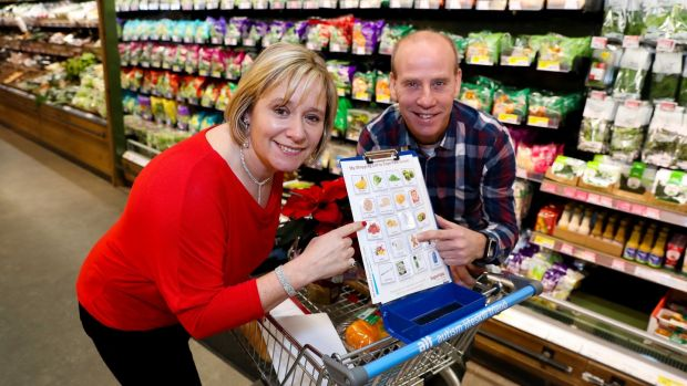 Theresa and Tony O'Dossnovan, creators of the Autism Lifeskill Friend trolley at the launch of SuperValu's Autism Friendly Shopping initiative. Photograph: Maxwell Photography