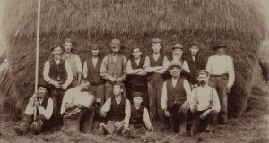 A 'meitheal' (gathering) of men drinking Guinness after the rick of hay is finished