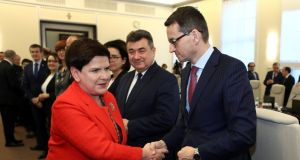 Poland's prime minister Beata Szydlo greeting finance minister Mateusz Morawiecki, who is tipped to succeed her, in Warsaw on Tuesday. Photograph: Slawomir Kaminski/Agencja Gazeta