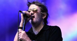 Shane MacGowan performing on stage with The Pogues in Greenwich in 2011. Photograph:  Matt Kent/Redferns