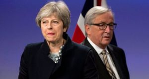 British prime minister Theresa May and European Commission president Jean-Claude Juncker prior to addressing a media conference at EU headquarters in Brussels. Photograph: Virginia Mayo/AP