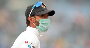 A Sri Lankan player wearing a face mask during his side's Test match against India. Photograph: Stringer/Reuters