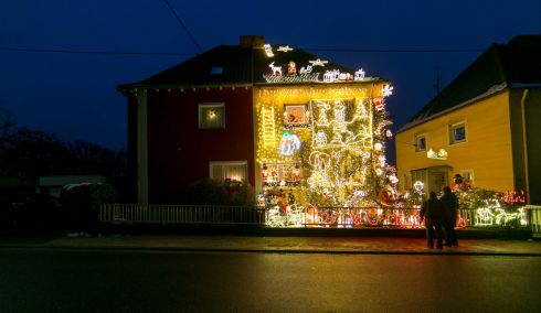 LIGHT CHRISTMAS: The home of Sven Berrar and Sven Schaan is illuminated with some 67,000 festive lights in Voelklingen, Germany. The pair are lighting up their house every evening from 5pm to 10pm. Photograph: Thomas Wieck/EPA