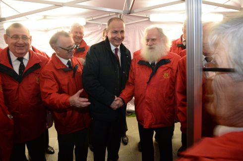 OIREACHTAS LIGHTS: Fianna Fáil leader Micheál Martin meets Ted Sweeney (right) and other members of the Cavan Rugby Club Male Voice Choir as the Oireachtas Christmas Tree lights at Leinster House are turned on. Photograph: Dara Mac Dónaill/The Irish Times
