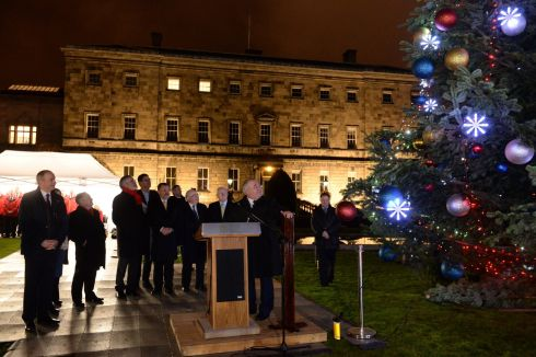 LIGHT RELIEF: Ceann Comhairle Seán Ó Fearghail switches on the Oireachtas Christmas Tree lights at Leinster House, joined by other members of the Oireachtas, with music and song provided by the Oireachtas Choir and the Cavan Rugby Club Male Voice Choir. Photograph: Dara Mac Dónaill/The Irish Times