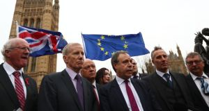 Deputy DUP leader Nigel Dodds (centre), and fellow DUP MPs, as Mr Dodds delivers a statement outside the Houses of Parliament in London. Photograph: Neil Hall/EPA