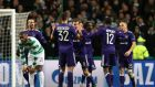 Anderlecht celebrate Jozo Simunovic's own goal at Celtic Park. Photograph: Ian MacNicol/Getty