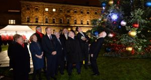 Ceann Comhairle Seán Ó Fearghail turns  on the Oireachtas Christmas tree lights at Leinster House. He was joined  by Cathaoirleach of the Seanad Denis O'Donovan, party leaders and other members of the Oireachtas with music and song provided by the Oireachtas choir and the Cavan Rugby Club male voice choir. Photograph: Dara Mac Dónaill