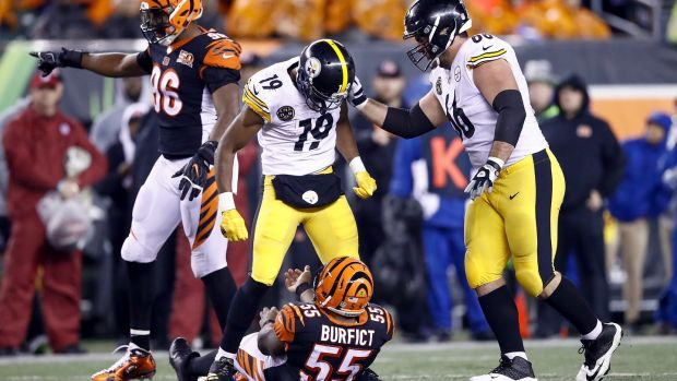 JuJu Smith-Schuster of the Pittsburgh Steelers stands over Vontaze Burfict of the Cincinnati Bengals. Photo: Andy Lyons/Getty Images