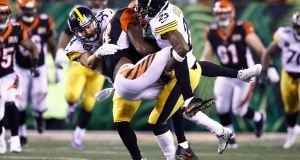 LJ Fort and Artie Burns of the Pittsburgh Steelers tackle AJ Green of the Cincinnati Bengals. Photo: Andy Lyons/Getty Images