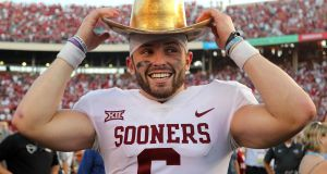 Baker Mayfield of the Oklahoma Sooners tries on the Golden Hat Trophy after a win over the Texas Longhorns in October. Photograph: Richard W Rodriguez/Getty Images