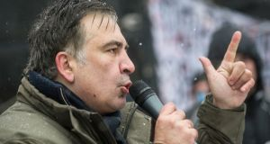 Former Georgian president Mikheil Saakashvili speaks  to his supporters as they camp out outside parliament demanding the resignation of the Ukrainian president, in Kiev, Ukraine, on  Wednesday. Photograph: Evgeniy Maloletka/AP