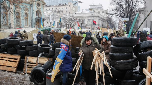 Mikheil Saakashvili supporters set up a barricade in their tent camp near of parliament building in Kiev, Ukraine. Photograph: Stepan Franko/EPA