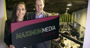 Maximum Media's agency sales director Tara Moran and managing director John Burns mark the announcement of 20 jobs for the company's  new Galway office.