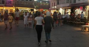 Jamil's mother Leila, and sister Carla, walking in a square in Greece en route to Germany in 2014.