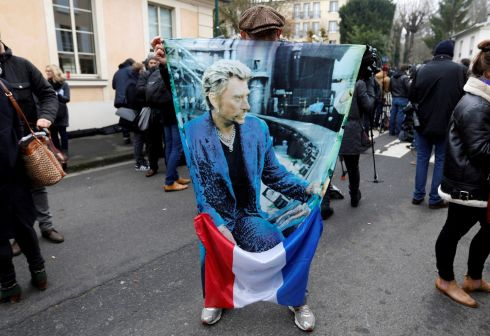 French fan Andre Duval with a poster of late French singer and actor Johnny Hallyday in Marnes-la-Coquette near Paris. Photograph: Reuters