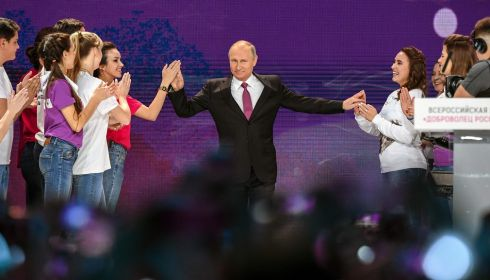 Russian President Vladimir Putin arrives to give a speech at a forum of volunteers in Moscow. Photograph: Getty Images
