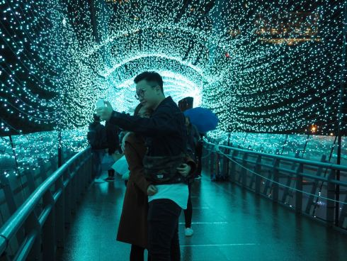 Young people take selfies in the Blue Time Corridor which is set up to celebrate Christmas in Banciao, New Taipei City, northern Taiwan. Photograph: EPA