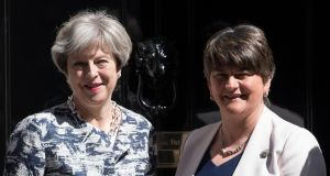Theresa May and Arlene Foster: the DUP this week helped to kill the thing it purports to love – the power and prestige of Britain. Photograph: Carl Court/Getty