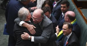 Liberal MP Warren Entsch (centre) hugs Australian prime minister Malcolm Turnbull (left) after the passing of the Marriage Amendment Bill in the House of Representatives at Parliament House in Canberra. Photograph: Lukas Coach/EPA