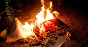 Palestinian demonstrators burn posters of the US president in Bethlehem's Manger Square in protest to him declaring Jerusalem as Israel's capital. Photograph: Musa Al Shaermusa Al Shaer/AFP/Getty Images