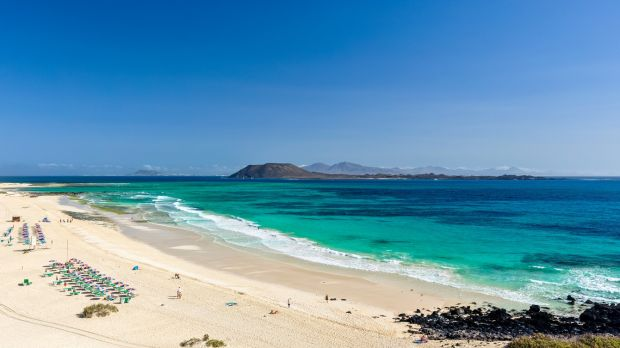 Beautiful turquoise water and white sand of Grandes Playas de Corralejo on Fuerteventura, Canary Islands, Spain,