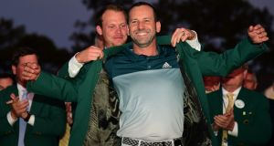 Danny Willett presents Sergio Garcia with the Green Jacket. Photograph: Harry How/Getty
