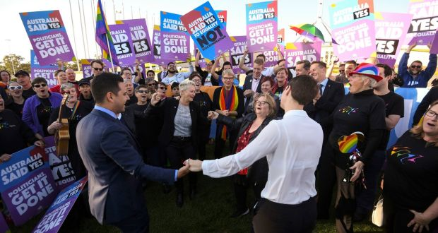 Same-sex marriage campaigners and volunteers  celebrate outside Parliament House in Canberra, on Thursday.  Photograph: Lukas Coch/AAP Image via AP