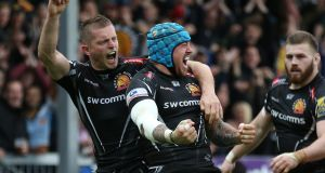 Exeter Chiefs' Jack Nowell   celebrates with team-mate Gareth Steenson (left) after scoring a  try during the Aviva Premiership semi-final against Saracens at Sandy Park.  Photograph: Steve Bardens/Getty Images