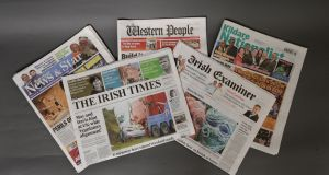 The Irish Times pictured with copies of titles owned by Landmark Media Investments. Photograph: Dara Mac Dónaill / The Irish Times
