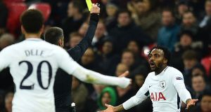 The referee books Tottenham Hotspur defender Danny Rose in the match against Apoel Nicosia at Wembley. Photograph: Glyn Kirk/AFP/Getty Images