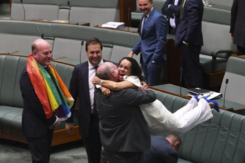 HAPPY DAY: Liberal MP Warren Entsch with Labor MP Linda Burney as they celebrate the passing of the Marriage Amendment Bill in the House of Representatives at Parliament House in Canberra, Australia. The passage of the bill effectively legalises same-sex marriage in Australia. Photograph: Lukas Coch/EPA